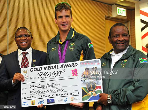 Medal winner Matthew Brittain poses with Fikile Mlalula and Gideon Sam during the South African Olympic team arrival and press conference at OR Tambo...