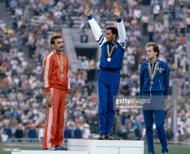 Medal winners from the Men's 20 kilometres walk event at the 1980 Summer Olympics stand and wave on the medal podium, with gold medallist Maurizio...