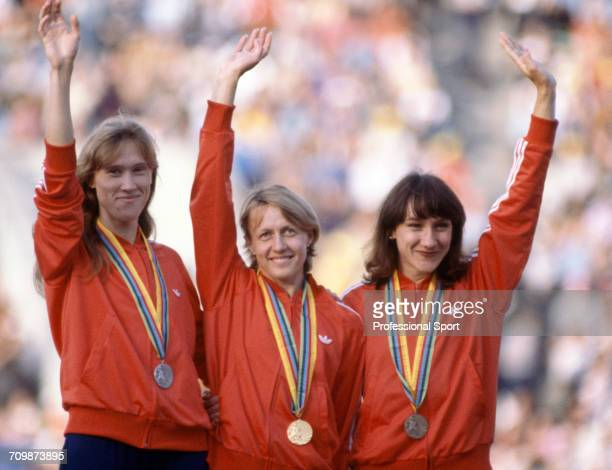 Medal winners from the Women's 800 metres event at the 1980 Summer Olympics stand and wave on the medal podium with gold medallist Nadezhda...