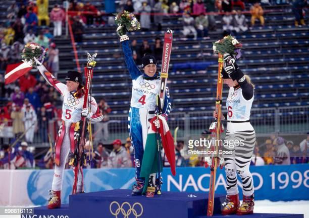 Medal winners in the Women's Giant Slalom event Alexandra Meissnitzer of Austria Deborah Compagnoni of Italy and Katja Seizinger of Germany celebrate...