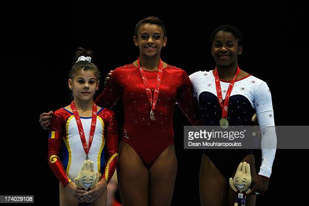 Medal winners Laura Jurca of Romania Elissa Downie of Great Britain and Tyesha Mattis of Great Britain for pose after the Girls Vault during Day 5 of...