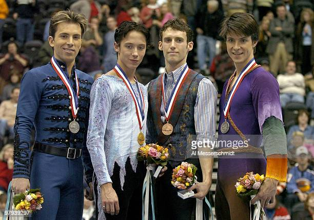 Medal winners Michael Weiss winner Johnny Weir Mathew Savoie and Ryan Jahnke January 10 2004 in the Men's Championship at the 2004 State Farm U S...