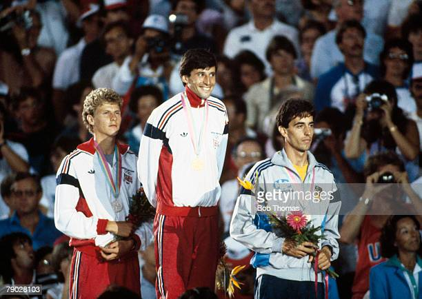 Medal winners of the Men's 1500 metres event stand together on the podium with from left to right silver medal winner Steve Cram of Great Britain...
