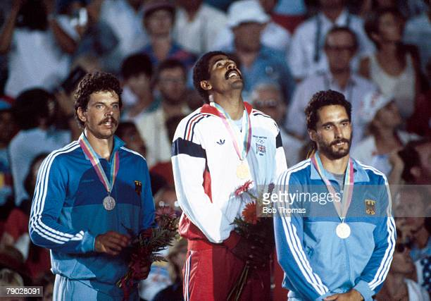 Medal winners of the Men's decathlon event stand together on the podium with, from left to right: silver medal winner Jurgen Hingsen of West Germany,...