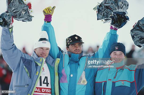 Medal winners of the Men's giant slalom Alpine skiing event at the 1992 Winter Olympics line up together on the podium from left to right silver...