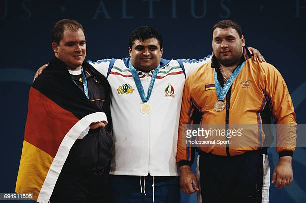 Medal winners of the Men's Super heavyweight 105 kg weightlifting event with silver medallist Ronny Weller of Germany on left gold medallist Hossein...