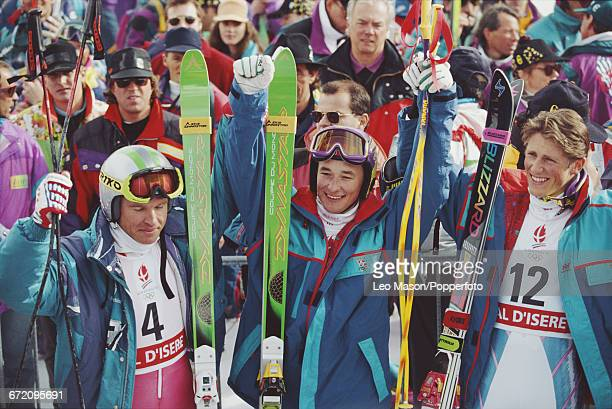 Medal winners of the Men's superG Alpine skiing event at the 1992 Winter Olympics line up together on the podium from left to right silver medal...