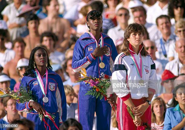 Medal winners of the Women's 400 metres event at the 1984 Summer Olympics line up together on the podium from left to right silver medal winner...
