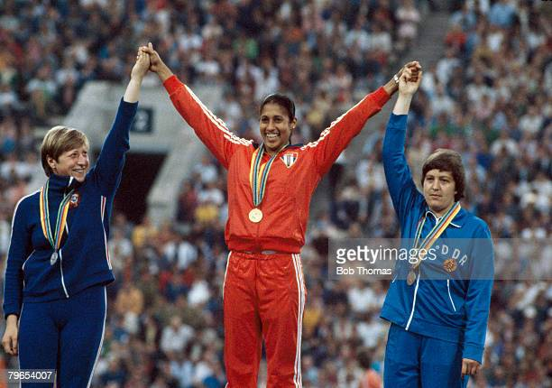 Medal winners of the Women's javelin throw event at the 1980 Summer Olympics line up together on the podium from left to right silver medal winner...