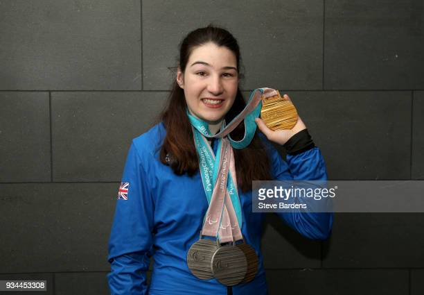 Medaliist Menna Fitzpatrick poses with her respective medals as Team ParalympicsGB arrive back from the PyeongChang 2018 Paralympic Winter Games at...