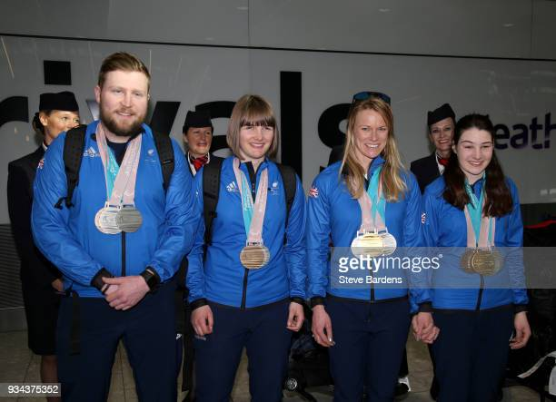 Medaliists Brett Wild Millie Knight Jen Kehoe and Menna Fitzpatrick pose with their respective medals as Team ParalympicsGB arrive back from the...