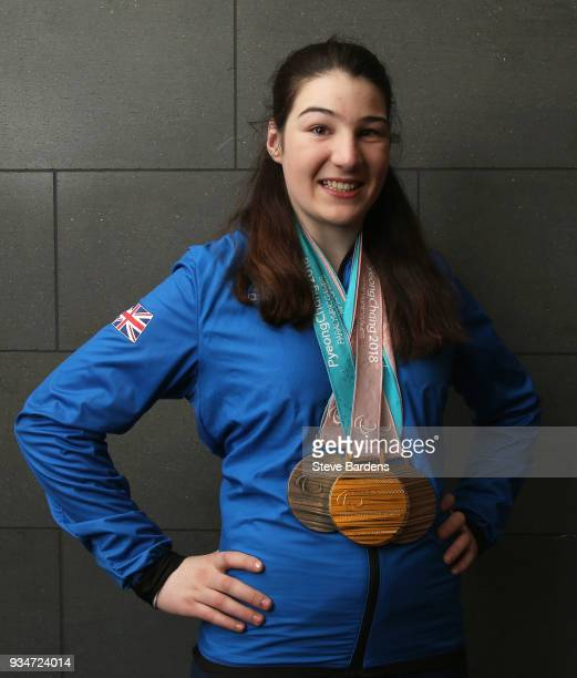 Medalist Menna Fitzpatrick poses with her respective medals as Team ParalympicsGB arrive back from the PyeongChang 2018 Paralympic Winter Games at...