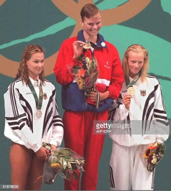 Medalist of the 200m freestyle Olympic swimming event Franziska van Almsick of Germany silver Claudia Poll of Costa Rica gold and Dagmar Hase of...