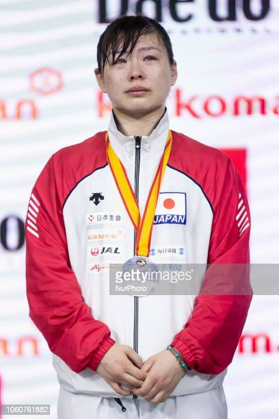 Medalist of the Kumite female 68kg competition silver Japanese Ayumi Uekusa pose on the podium of the 24th Karate World Championships at Wizink...
