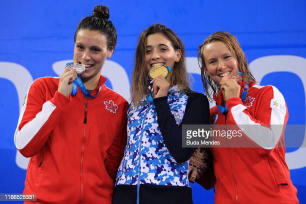 Medalists Danica Ludlow of Canada Delfina Pignatiello of Argentina and Alyson Patricia Ackman of Canada in the podium of Women's 100m Breaststroke...