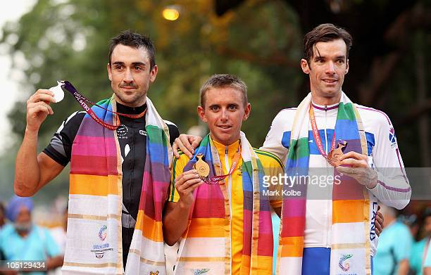 Medalists Hayden Roulston of New Zealand , Allan Davis of Australia and David Millar of Scotland pose during the medal ceremony for the Men's Road...