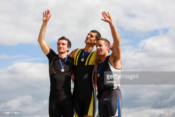 medalists of the competition - winners podium stock pictures, royalty-free photos & images