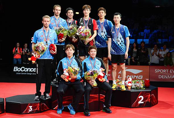 Medalists pose on the podium after the men's double final ...