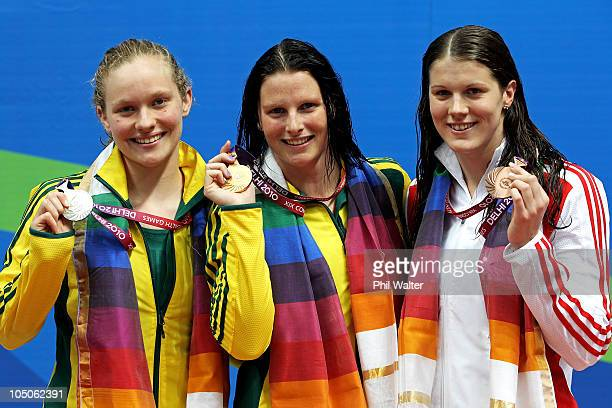 Medalists Samantha Marshall of Australia , Leisel Jones of Australia and Kate Haywood of England pose during the medal ceremony for the Women's 100m...