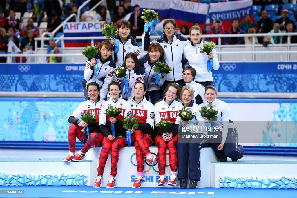 Medalists South Korea, Canada and Italy celebrate on the podium during the flower ceremony for the Short Track Ladies' 3000m Relay at Iceberg Skating Palace on day 11 of the 2014 Sochi Winter Olympics on February 18, 2014 in Sochi, Russia.