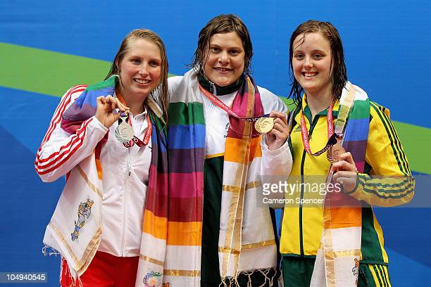 Medalists Stephanie Millward of England Natalie Du Toit of South Africa and Ellie Cole of Australia pose during the medal ceremony for the Women's...