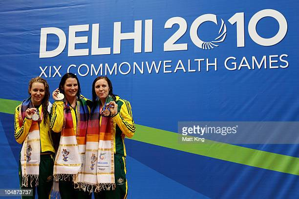 Medalists Tessa Wallace of Australia , Leisel Jones of Australia and Sarah Katsoulis of Australia pose during the medal ceremony for the Women's 200m...