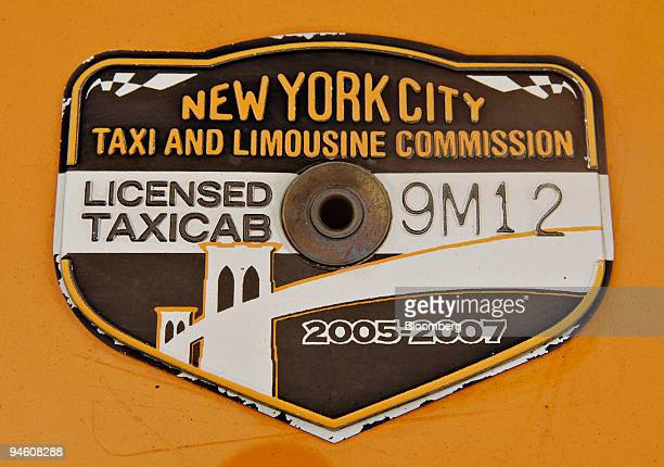 A medallion is pictured on the hood of a taxi in New York Wednesday June 14 2006 In New York the capital of world finance the hottest investment...