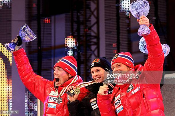 Medallists Eldar Roenning of Norway, Matti Heikkinen of Finland and Martin Johnsrud Sundby of Norway pose w ith the medals won in the Men's Cross...