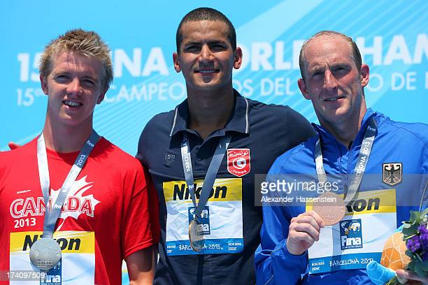 Medallists Eric Hedlin of Canada Oussama Mellouli of Tunisia and Thomas Luhr of Germany pose with their medals after the Open Water Swimming Men's 5k...