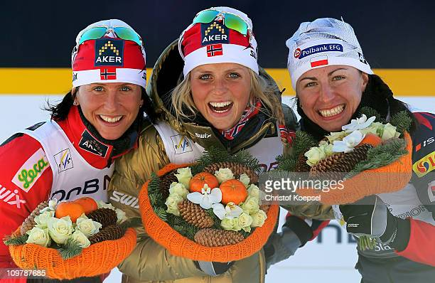 Medallists Marit Bjoergen of Norway Therese Johaug of Norway and Justyna Kowalczyk of Poland celebrate following the Ladies Cross Country 30km Mass...