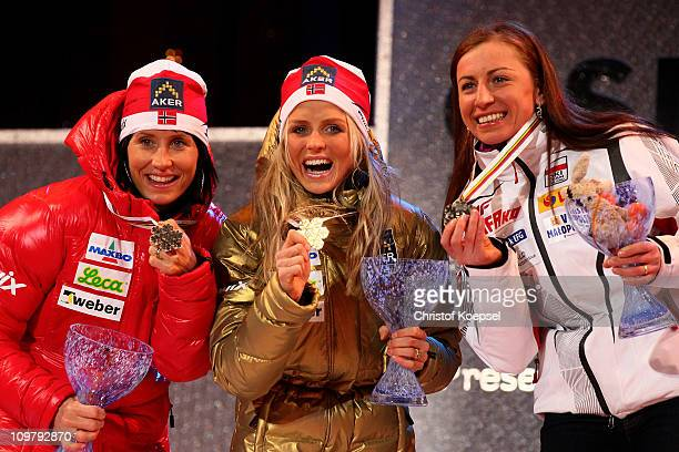 Medallists Marit Bjoergen of Norway Therese Johaug of Norway and Justyna Kowalczyk of Poland celebrate with the medals won in the Ladies Cross...