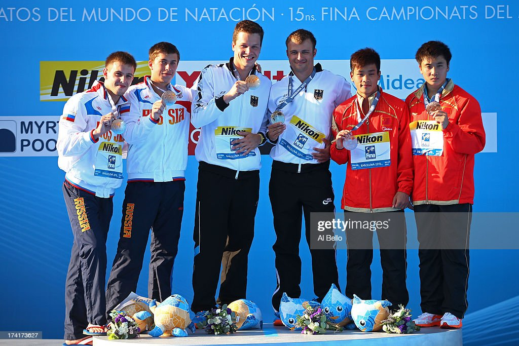 Medallists Victor Minibaev and Artem Chesakov of Russia (silver), Patrick Hausding and Sascha Klein of Germany (gold) and Zhang Yanguan and Cao Yuan of China (bronze) pose on the podium after the Men's 10m Platform Synchronised Diving final on day two of the 15th FINA World Championships at Piscina Municipal de Montjuic on July 21, 2013 in Barcelona, Spain.