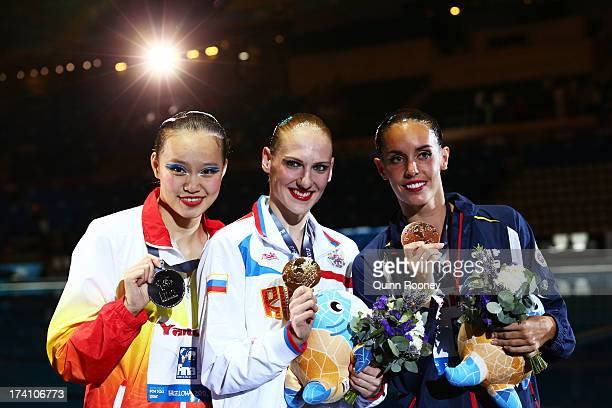 Medallists Xuechen Huang of China Svetlana Romashina of Russia and Carbonell Ballestero of Spain pose after the Synchronized Swimming Solo Technical...