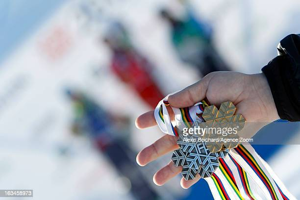 Medals are held during the FIS Freestyle Ski World Championship Men's and Women's Ski Cross on March 10 2013 in Voss Norway