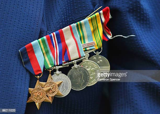 Medals are seen displayed on the suit jacket of Ferris Ashton a war veteran and former Easts player during a prematch ANZAC Day ceremony prior to the...