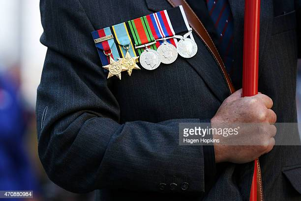 Medals are seen on the chest of a banner holder during the Anzac Day eve street parade on April 24 2015 in Wellington New Zealand The parade was...