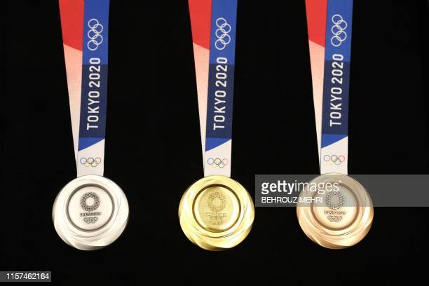 Medals for the Tokyo 2020 Olympic Games are unveiled during a ceremony marking one year before the start of the games in Tokyo on July 24 2019 Tokyo...