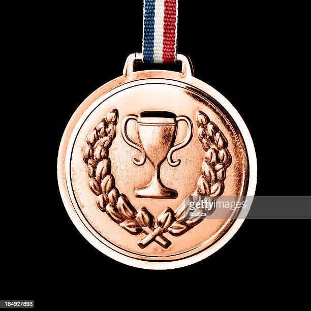 . medals isolated on black: bronze - bronze medalist stock pictures, royalty-free photos & images