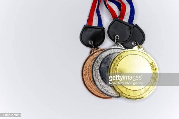 medals on white background - the olympic games stock pictures, royalty-free photos & images