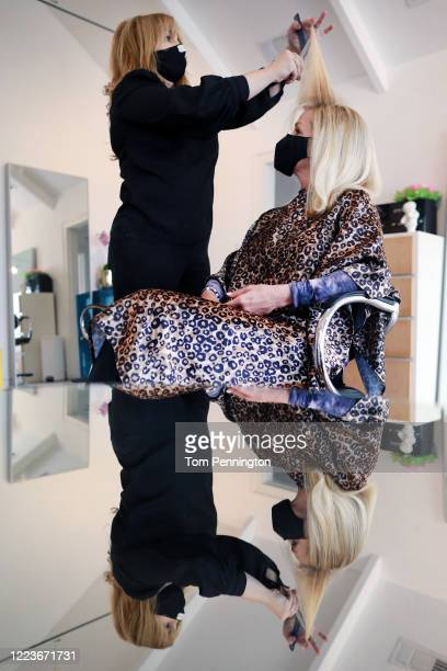 Medea Micham has her hair cut by stylist Jill Cespedes at Shampoo Salon on May 08 2020 in Fort Worth Texas Texas Govenor Greg Abbott announced that...