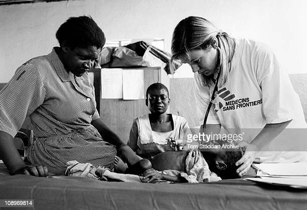 Medecins Sans Frontieres doctor tends to patients inside Chiradzulu District Hospital in Malawi where there are just 98 beds for 190 patients in an...