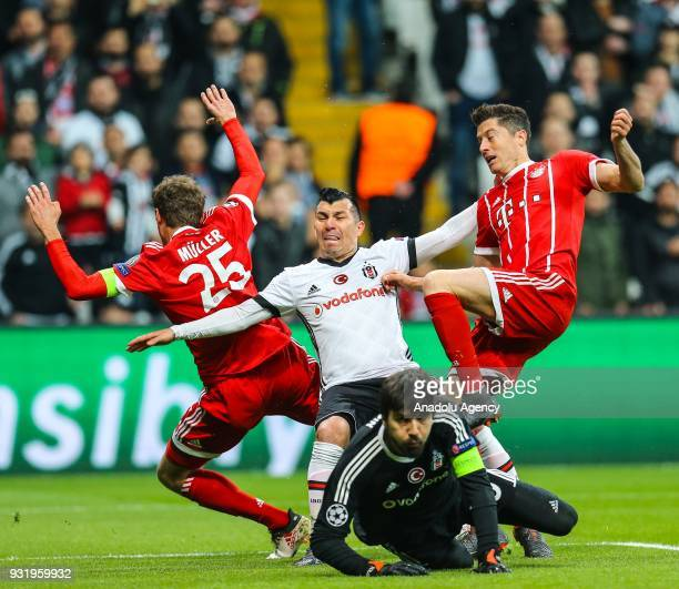 Medel and goalkeeper Tolga Zengin of Besiktas in action against Thomas Mueller and Robert Lewandowski of Bayern Munich during the UEFA Champions...