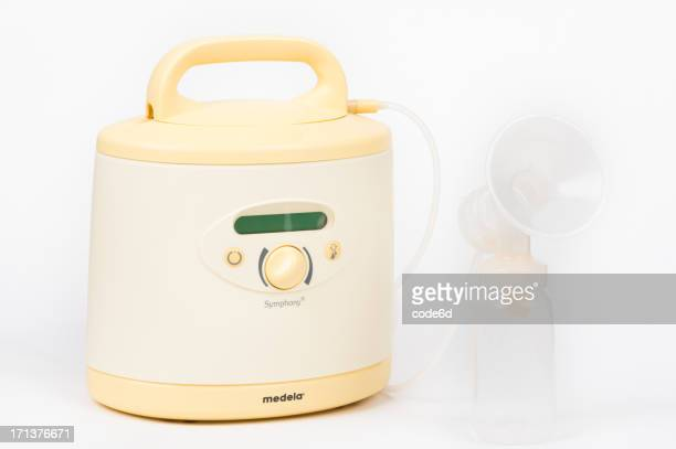 medela symphony brest pump isolated on white - breast pump stock pictures, royalty-free photos & images