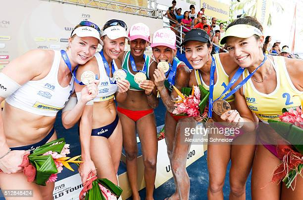 Medeleine Meppelink and Marleen Van Ierse of Netherlands won the silver medal Duda Lisboa and Elize Maia of Brazil show the gold medal and Agatha...
