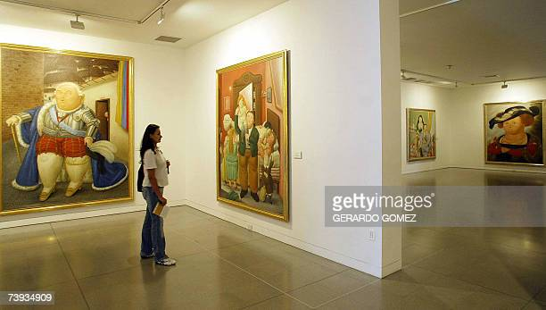 A woman visits Colombian artist Fernando Botero's permanent exhibition at the Antioquia Museum of Art April 16 2007 in Medellin Colombia Botero's...
