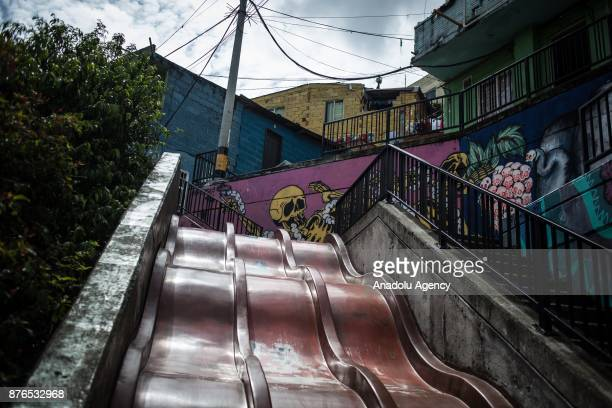 A skeleton graffiti over the slides is seen in Medellin Colombia on November 19 2017 Mural graffitis from different artists street art can be seen in...