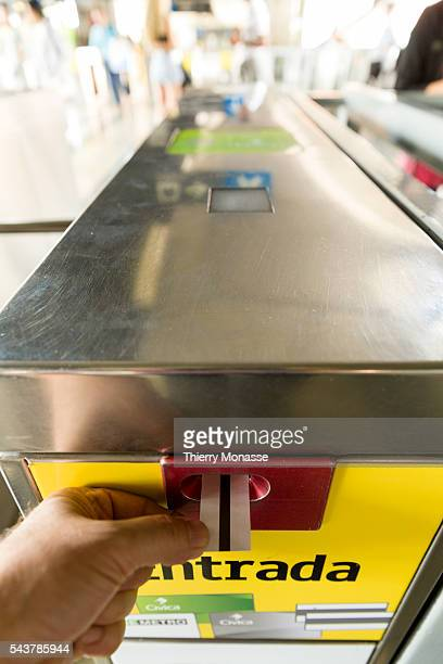 Medellín Republic of Colombia August 26 2015 A passenger put the ticket into the baffle gate