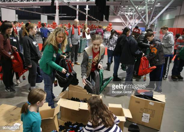Medford Girl Scout Troop Leader Monique O'Connell left and her daughter Marianne O'Connell right volunteer for a charity event at the Boston...