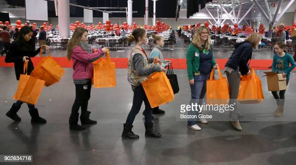 Medford Girl Scout Troop Leader Monique O'Connell third from right and her troop volunteer for an upcoming charity event at the Boston Convention...