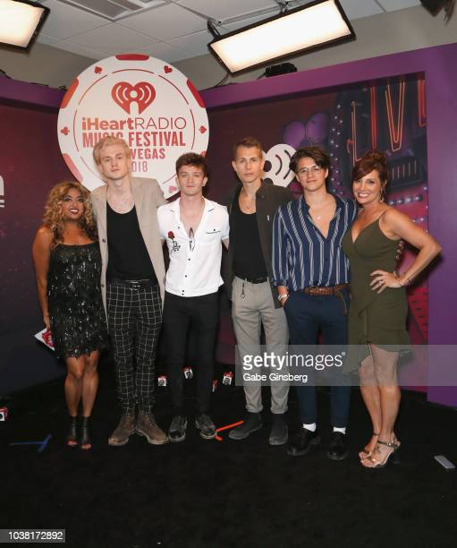Medha Gandhi and Danielle Monaro pose with Tristan Evans Connor Ball James McVey and Bradley Simpson of The Vamps during the iHeartRadio Music...
